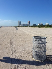 The trash cans line the entire beach and we use them as a marker for our sprint intervals.